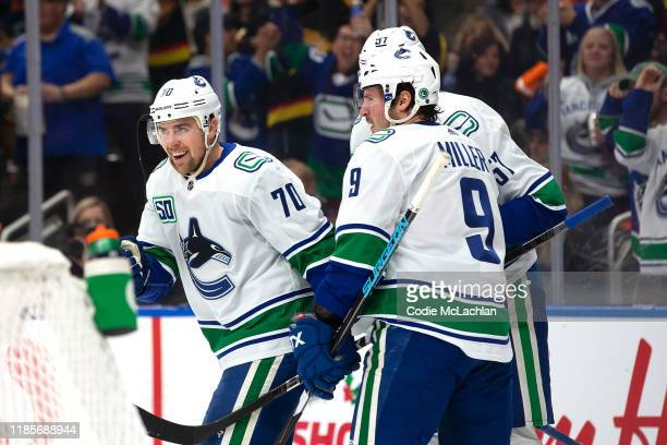 Tanner Pearson, J.T. Miller and Tyler Myers of the Vancouver Canucks celebrate a goal against the Edmonton Oilers at Rogers Place on November 30,...
