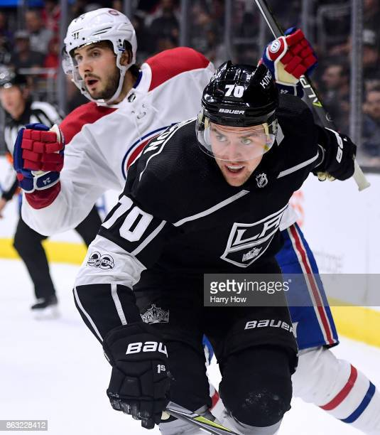 Tanner Pearson of the Los Angeles Kings and Tomas Plekanec of the Montreal Canadiens bump as they chase after play at Staples Center on October 18...