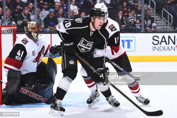 Tanner Pearson of the Los Angeles Kings battles in front of the net against Peter Holland and Mike Smith of the Arizona Coyotes during the game on...
