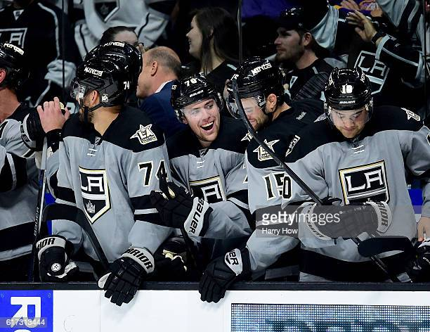 Tanner Pearson of the Los Angeles Kings celebrates his goal on the bench to take the lead during the overtime shootout period against the Vancouver...