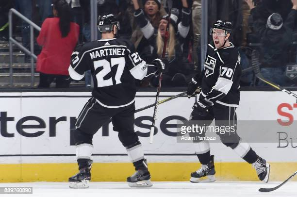 Tanner Pearson of the Los Angeles Kings celebrates with Alec Martinez after scoring the gamewinning goal in overtime against the Carolina Hurricanes...