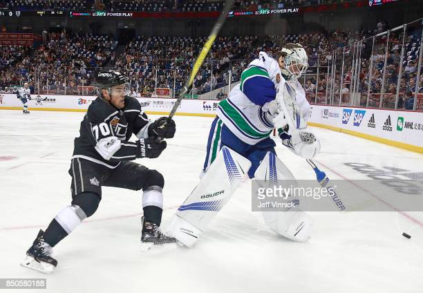 Tanner Pearson of the Los Angeles Kings checks Jacob Markstrom of the Vancouver Canucks as he clears the puck during their preseason game against the...