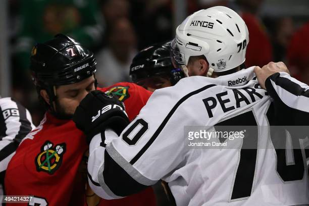 Tanner Pearson of the Los Angeles Kings fights with Brent Seabrook of the Chicago Blackhawks during Game Five of the Western Conference Final in the...