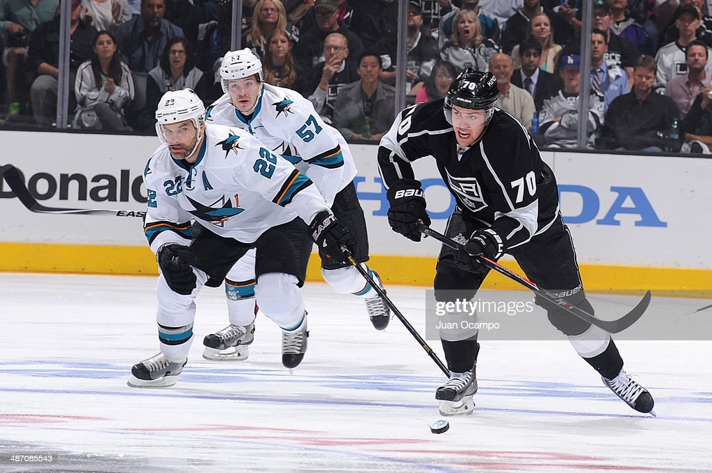 Tanner Pearson #70 of the Los Angeles Kings handles the puck while being pursued by Dan Boyle #22 of the San Jose Sharks in Game Four of the First Round of the 2014 Stanley Cup Playoffs at STAPLES Center on April 24, 2014 in Los Angeles, California.