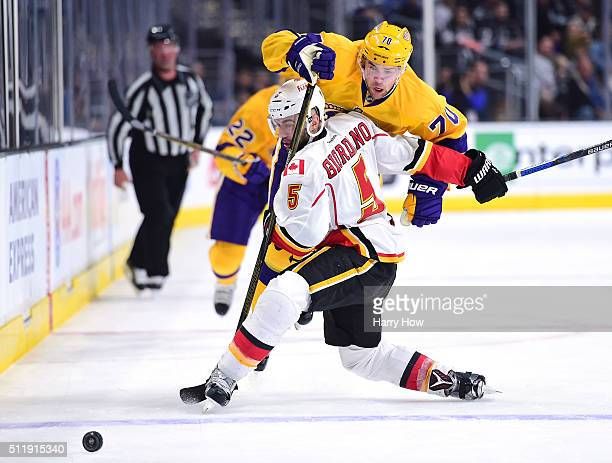 Tanner Pearson of the Los Angeles Kings is checked by Mark Giordano of the Calgary Flames during the second period at Staples Center on February 23...