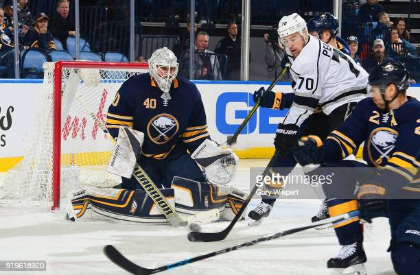 Tanner Pearson of the Los Angeles Kings looks for a rebound as goaltender Robin Lehner of the Buffalo Sabres makes a save during the second period of...