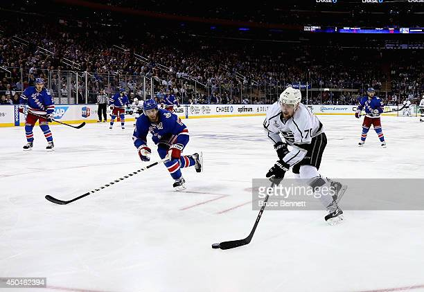 Tanner Pearson of the Los Angeles Kings skates against Dan Girardi of the New York Rangers during the third period of Game Four of the 2014 NHL...