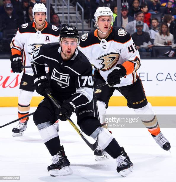 Tanner Pearson of the Los Angeles Kings skates against Josh Manson and Cam Fowler of the Anaheim Ducks during the game on September 30 2017 at...