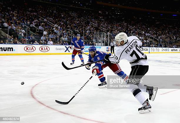 Tanner Pearson of the Los Angeles Kings takes a shot past Dan Girardi of the New York Rangers during the third period of Game Four of the 2014 NHL...