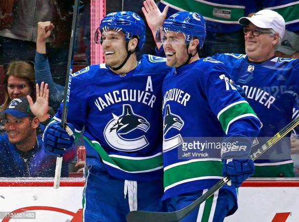 Tanner Pearson of the Vancouver Canucks is congratulated by teammate Bo Horvat after scoring during their NHL game against the San Jose Sharks at...