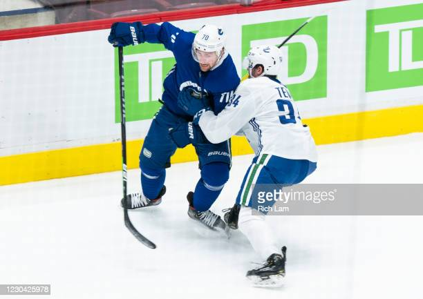 Tanner Pearson of the Vancouver Canucks tries to get around Josh Teves during a drill on the first day of the Vancouver Canucks NHL Training Camp at...