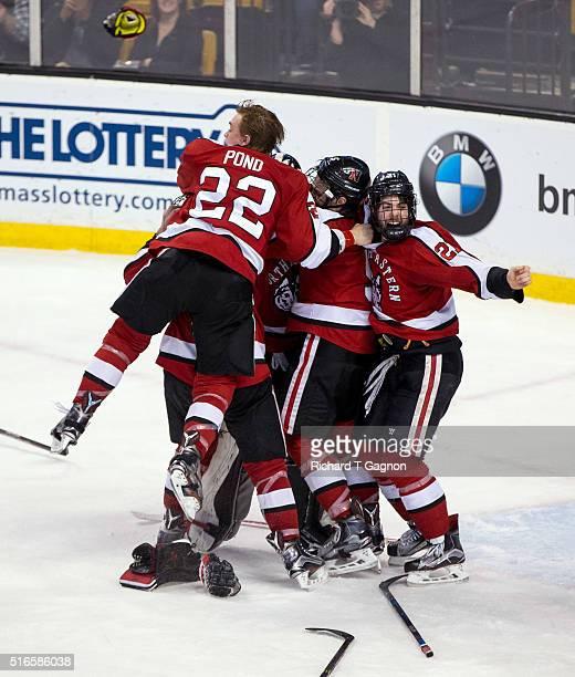 Tanner Pond of the Northeastern Huskies jumps on his teammates Zach Aston-Reese, Nolan Stevens, Matt Benning and Ryan Ruck after NCAA hockey as...