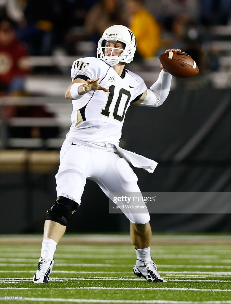 Tanner Price #10 of the Wake Forest Demon Deacons throws a pass against the Boston College Eagles in the second half during the game on September 6, 2013 at Alumni Stadium in Chestnut Hill, Massachusetts.