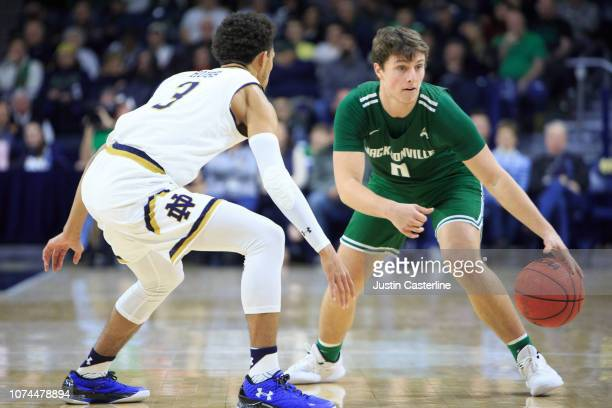 Tanner Rubio of the Jacksonville Dolphins looks to make a move in the game against the Notre Dame Fighting Irish in the second half at Purcell...