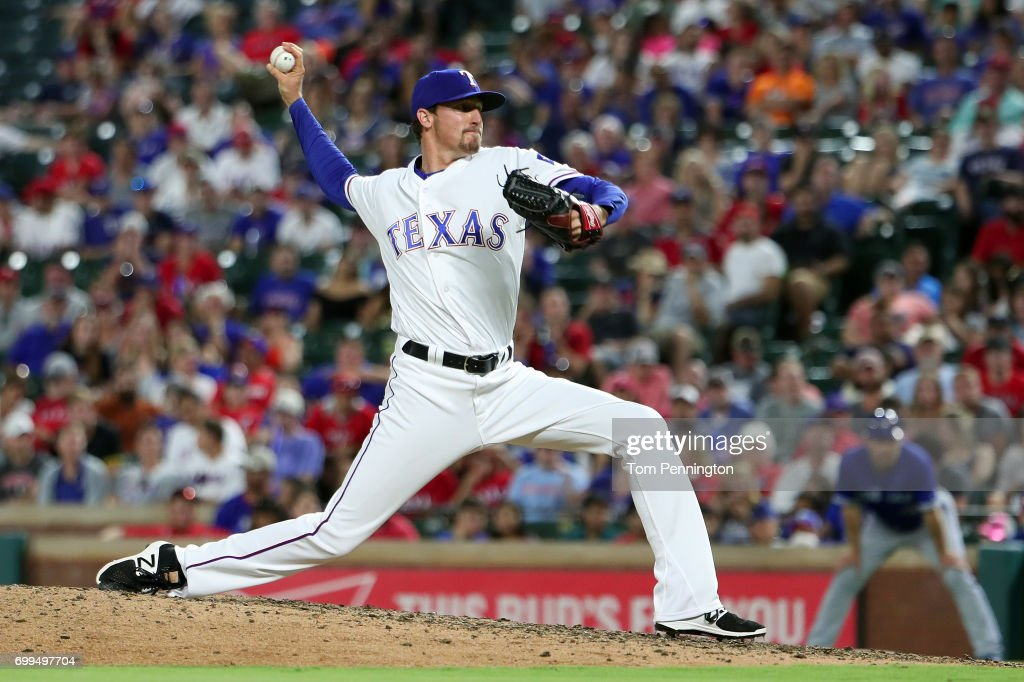 Tanner Scheppers #52 of the Texas Rangers pitches against the Toronto Blue Jays in the top of the eighth inning at Globe Life Park in Arlington on June 21, 2017 in Arlington, Texas.