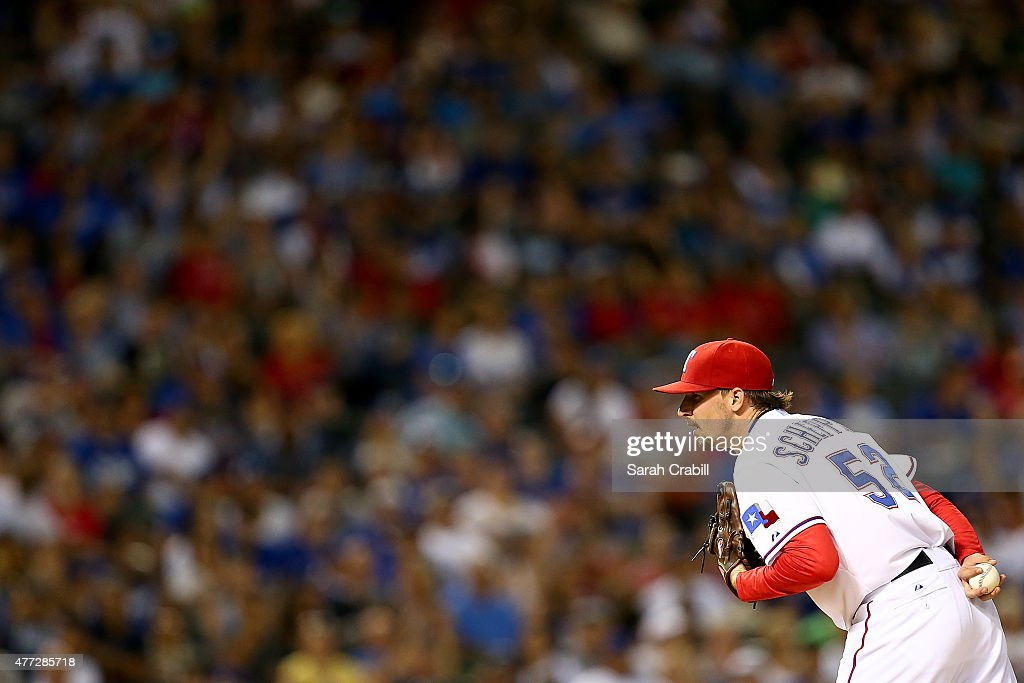 Tanner Scheppers #52 of the Texas Rangers pitches in the eighth inning during a game against the Los Angeles Dodgers at Globe Life Park in Arlington on June 15, 2015 in Arlington, Texas. The Texas Rangers defeated the Los Angeles Dodgers 4-1.
