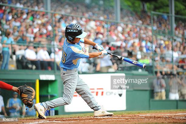 Tanner Tokunaga of the Waipio Little League team hits a home run during the World Series Championship game against the Matamoros Little League team...