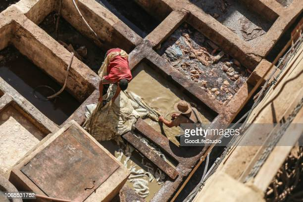 tanneries in fes - textile factory stock photos and pictures
