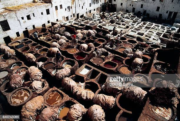 Tanning and dyeing tanks tanner's district of Chouara Fes Morocco