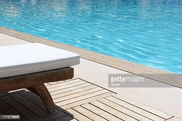 tanning beds in resort - standing water stock pictures, royalty-free photos & images