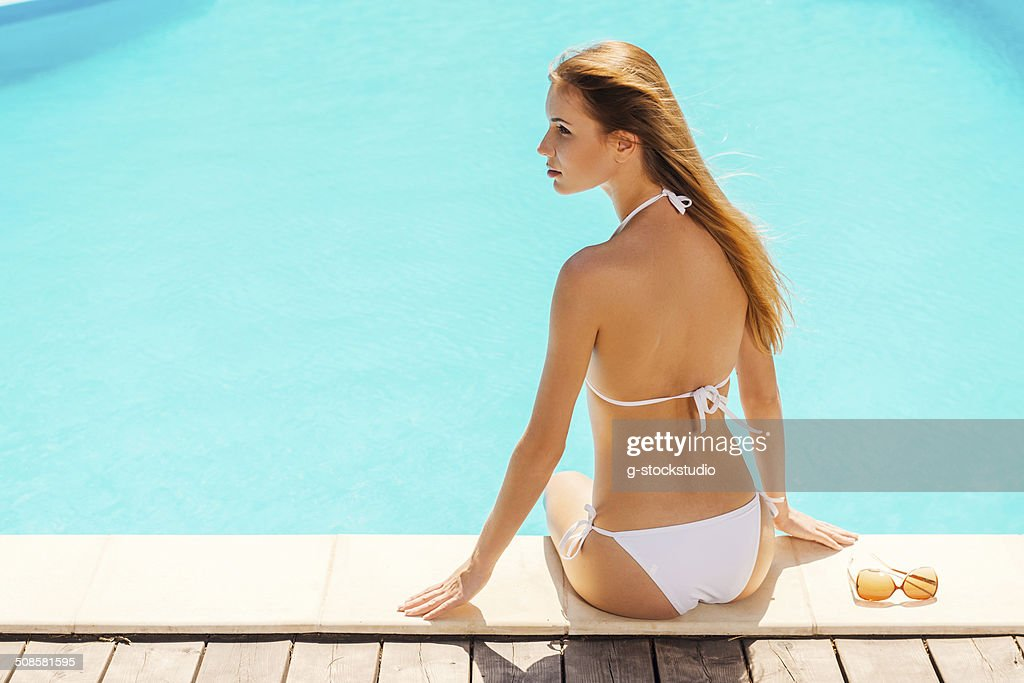 Tanning poolside. : Stock Photo