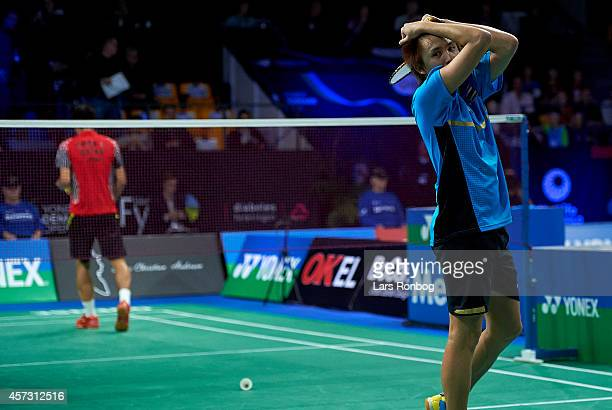 Tanongsak Saensomboonsuk of Thailand looks dejected in his match against Chen Long of China during the Yonex Denmark Open MetLife BWF World...