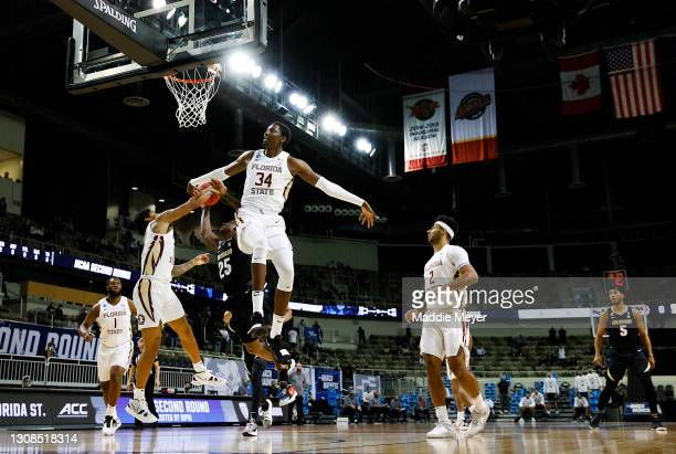 Tanor Ngom of the Florida State Seminoles blocks a shot from McKinley Wright IV of the Colorado Buffaloes during the first half in the second round...