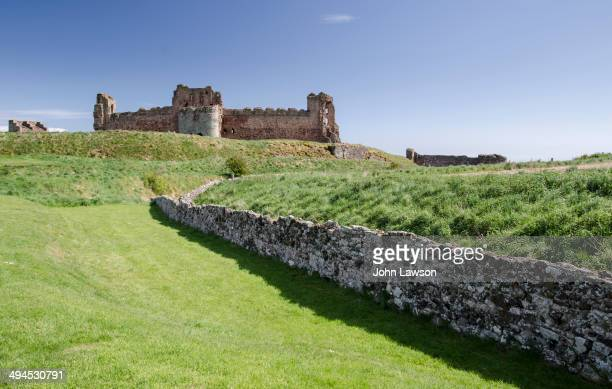 CONTENT] Tantallon Castle is a semiruined mid14thcentury fortress located 5 kilometres east of North Berwick in East Lothian Scotland It sits atop a...
