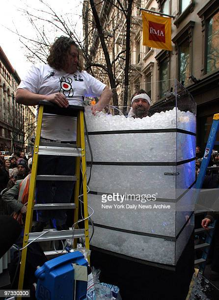 Tantric Master Wim Hof submerges himself up to his neck in ice cubes for a Guinness record breaking 71 minutes on W17st in Manhattan