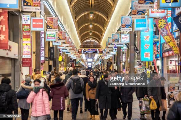 tanukikoji shopping street is a landmark of sapporo, hokkaido, japan - ショッピングエリア ストックフォトと画像