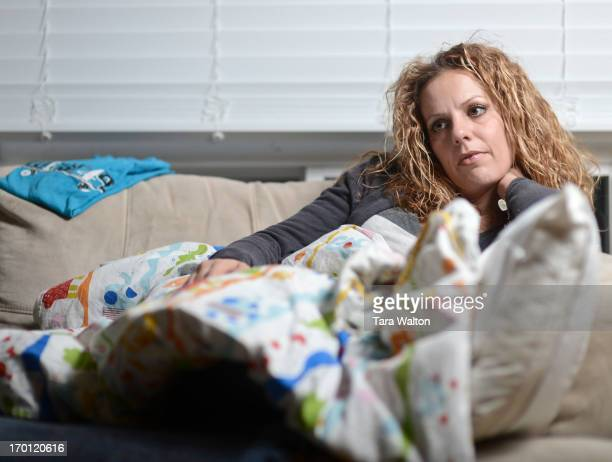 Tanya Brancalion the women whose son Noah was killed by his father in a murdersuicide this fall sits on her living room couch nestled under her sons...