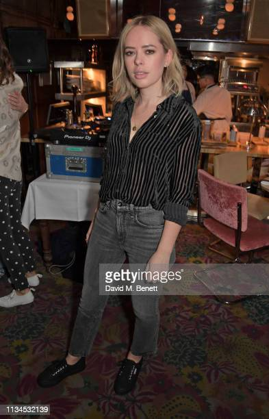 Tanya Burr attends an exclusive dinner to celebrate the launch of the Alexa Chung and Superga SS19 collection at Gloria Trattoria on April 2 2019 in...