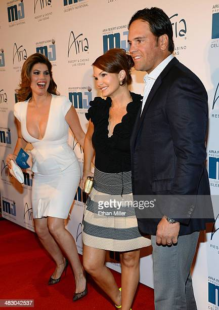 Tanya Callau photobombs Alicia Rickter and her husband former Major League Baseball player Mike Piazza as they arrive at the 13th annual Michael...