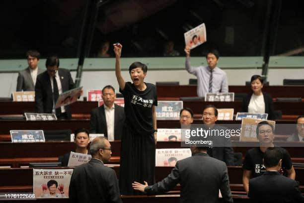 Tanya Chan, legislator and member of Civic Party, center, protests during Hong Kong Chief Executive Carrie Lam's policy address at the Legislative...