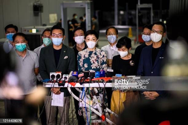 Tanya Chan of the Civic Party and other prodemocracy lawmakers gather outside the entrance of the Legislative Council for a press conference in Hong...