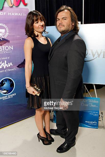 Tanya Haden and Jack Black attend the poster signing event for charity during the Critics' Choice Movie Awards 2013 at Barkar Hangar on January 10...