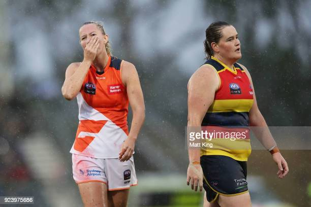 Tanya Hetherington of the Giants and Sarah Perkins of the Crows react to the draw at fulltime during the round four AFLW match between the Greater...