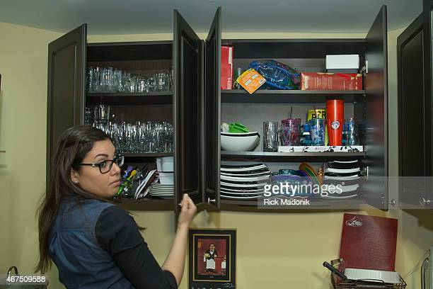 THORNHILL MARCH 25 Tanya Hyams looks through her cupboard of Passover dishes for a bowl Lamb curry for Passover is not a dish well known but for Jews...
