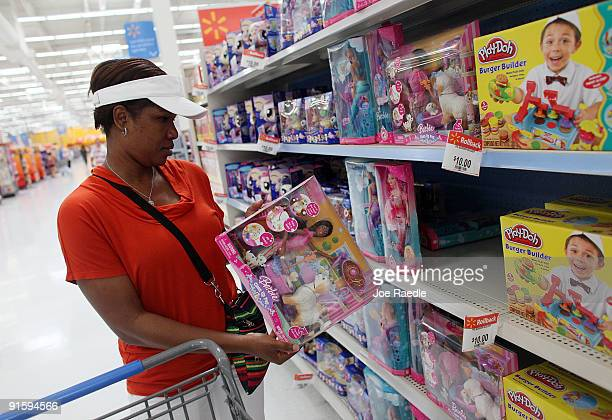 Tanya Johnson shops in the toy department of the WalMart store on October 8 2009 in Pompano Beach Florida WalMart stores Inc announced recently that...