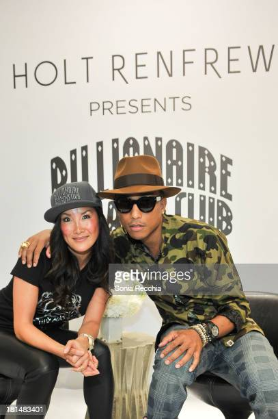 Tanya Kim and Pharrell Williams make a personal appearance at Holt Renfrew Yorkdale on September 21 2013 in Toronto Canada