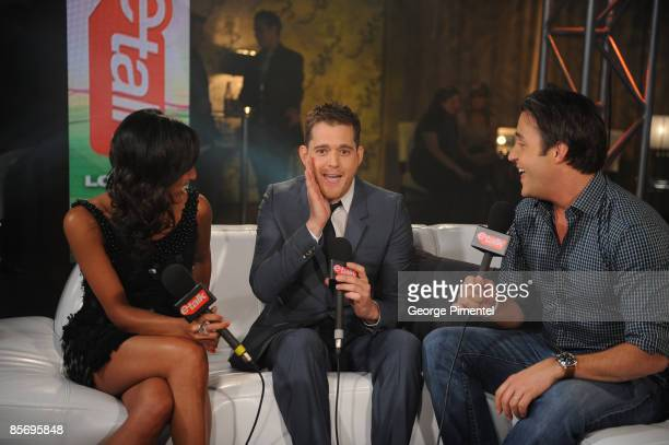 Tanya Kim Singer Michael Buble and Ben Mulroney backstage in the E Talk Lounge at the 2009 Juno Awards at General Motors Place on March 29 2009 in...