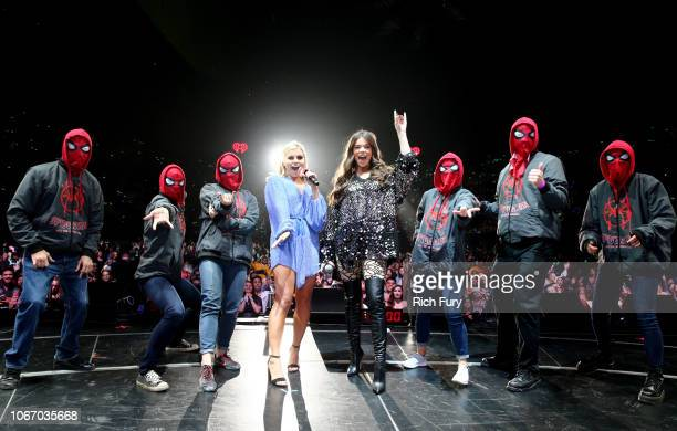 Tanya Rad and Hailee Steinfeld speak onstage while joined by people dressed as SpiderMan during 1027 KIIS FM's Jingle Ball 2018 Presented by Capital...