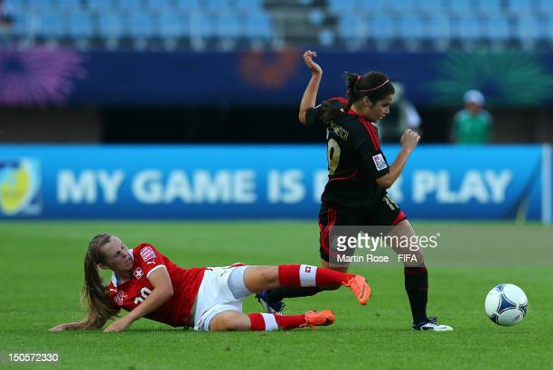 Tanya Samarzich of Mexico and Noelle Maritz of Switzerland battle for the ball during the FIFA U20 Women's World Cup 2012 group A match between...