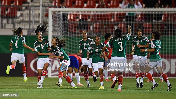 Tanya Samarzich of Mexico celebrates with team mates after scoring during the FIFA U20 Women's World Cup Canada 2014 Group D match between Korea...