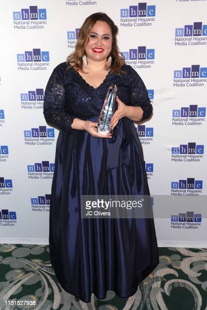 Tanya Saracho poses with the 'Outstanding Television Series Impact Award' for the tv series 'Vida' during the 22nd Annual National Hispanic Media...