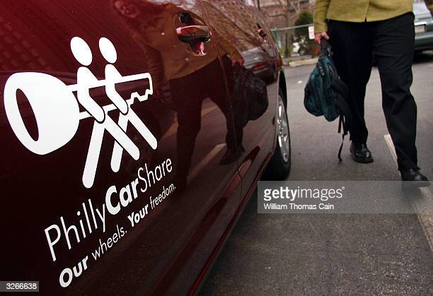 Tanya Seaman carries her belongings as she prepares to drive a PhillyCarShare Prius April 8 2004 in Philadelphia Pennsylvania Philadelphia is selling...