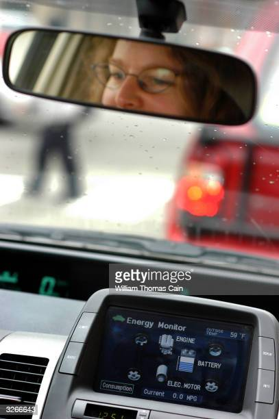 Tanya Seaman drives a PhillyCarShare Prius as a computer monitor shows the energy the vehicle is consuming April 8 2004 in Philadelphia Pennsylvania...