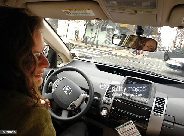 Tanya Seaman drives a PhillyCarShare Prius through the streets April 8 2004 in Philadelphia Pennsylvania Philadelphia is selling off hundreds of...