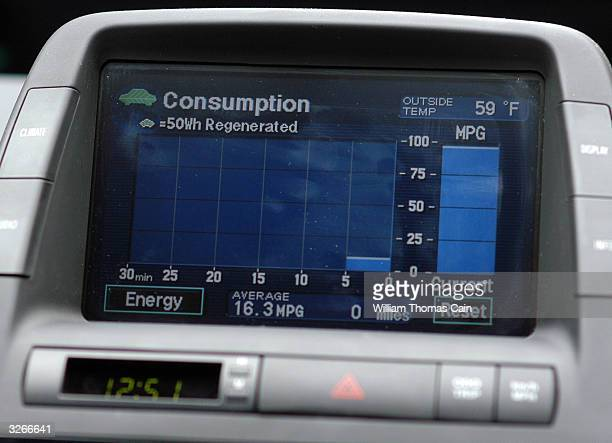 Tanya Seaman not shown drives a PhillyCarShare Prius as a computer monitor shows the energy the vehicle is consuming April 8 2004 in Philadelphia...