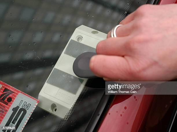 Tanya Seaman unlocks the door to a PhillyCarShare Prius with her electronic key April 8 2004 in Philadelphia Pennsylvania Philadelphia is selling off...